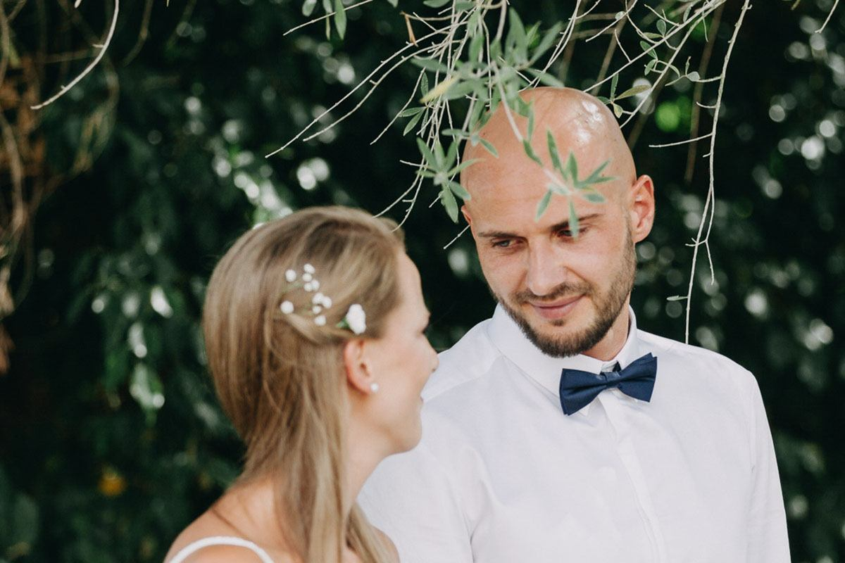 mallorca elopement photographer - groom looks at the bride
