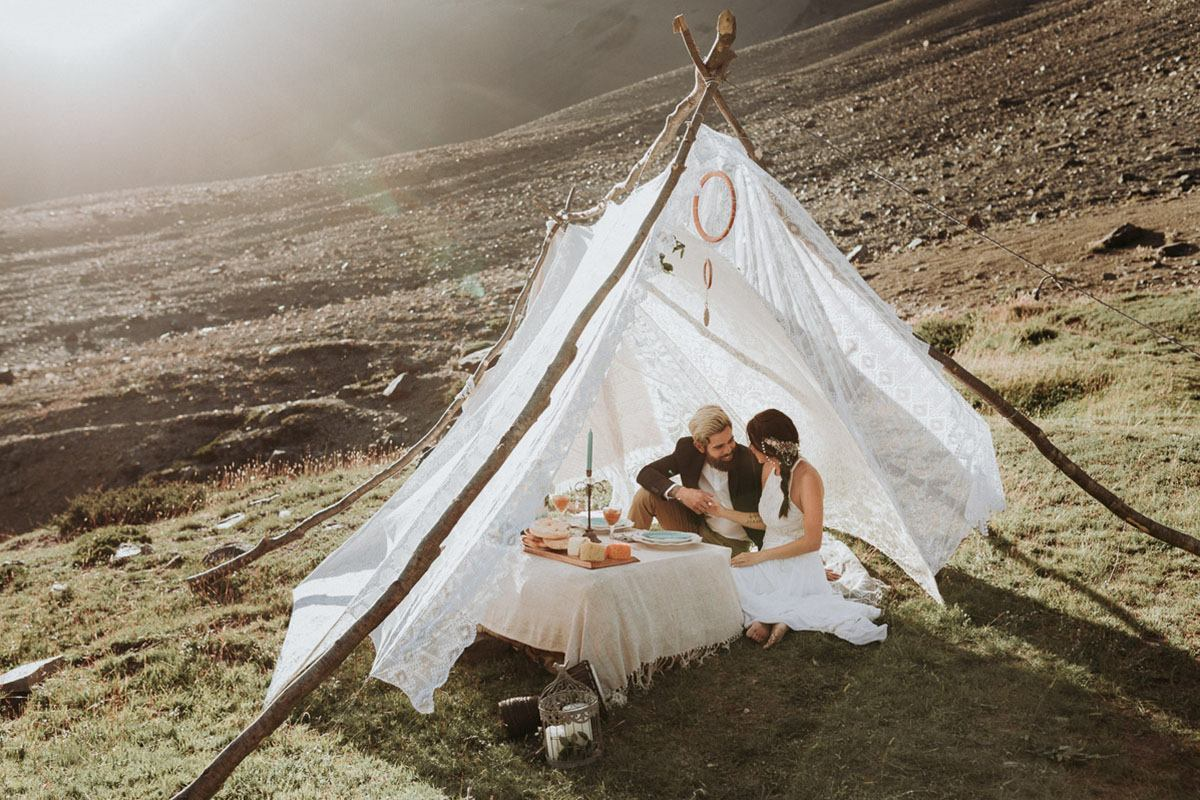 Destination wedding photographer in Chile photographs boho couple at mountain elopement