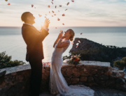 elopement photographer Spain - Romany Flower - exhuberant wedding couple at their hiking elopement